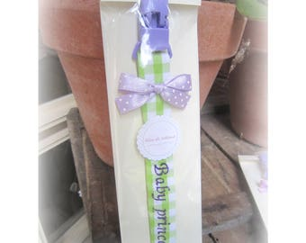 Cotton pacifier holder with bow and embroidered phrase