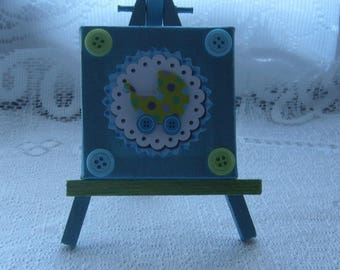 Table cloth for baby's room with prams and 4 buttons on her easel