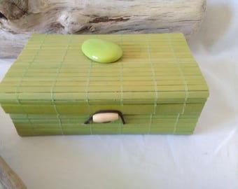 wooden box with green bamboo