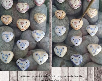 Doors incense with the signs of Zodiac clay hearts