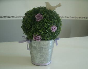 plant plastic ball decorated with flowers in a zinc pot