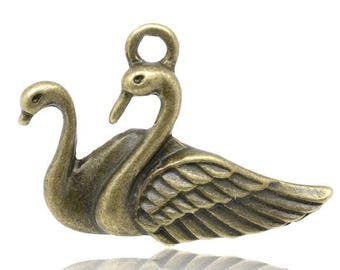 4 charms in antique bronze Swan couple