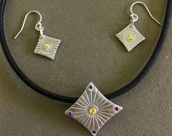 Jewellery from 950 silver, studded with Zirkonien