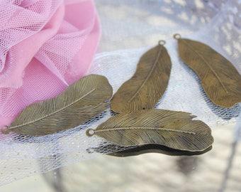 Lot de 4 plumes bronze -dim 5,3 cm X 1,8 cm