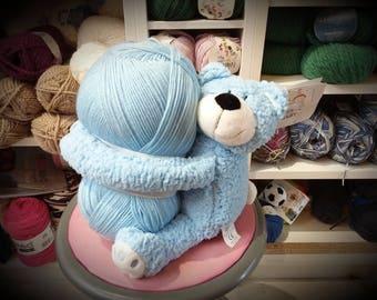 Baby Blue Bear Hug, a blanket and a ball