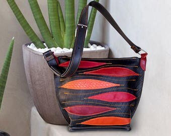 Purse in inner tube recycled topstitched leather tones red in ethnic style.