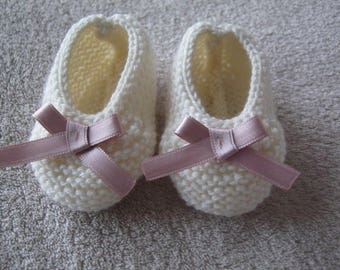 Powder pink satin bow and ecru wool baby shoes.