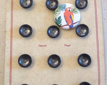 Old plate of 12 grey buttons
