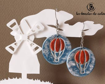 Earrings: red hot air balloons on blue background