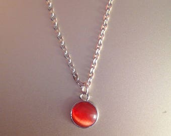 Red orange cat's eye and silver nickel pendant necklace