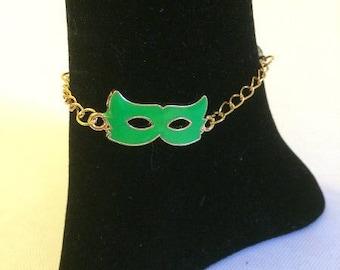 Golden bracelet with green mask