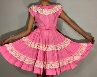1950s pink square dance dress with lace trim