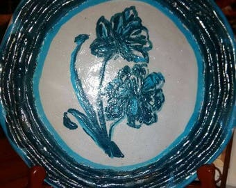 Beautiful stone pottery plate . gorgeous flowers .