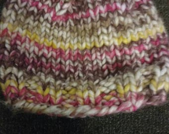 Pink, yellow, white, and browns messy bun winter beanie