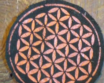 Hand stenciled Flower of Life patch on leather