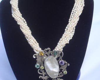 Calypso: 10 strands of freshwater pearls and sterling silver Choker necklace