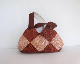 Light brown brick tone assembled Argyle cotton handbag