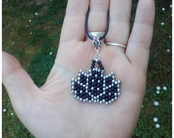 Woven lotus flower pendant