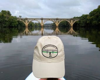 Organic cotton baseball hat with custom embroidered design of Frederickbsurg VA FXBG bridge SUP stand up paddle on Rappahannock River