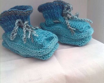 Baby blue hand-knitted booties