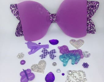 Purple jelly bow with purple glitter tails