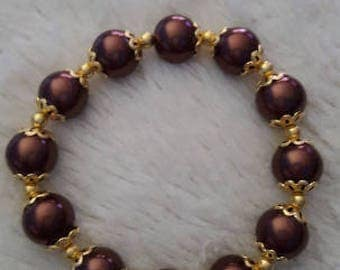 Handmade womens brown pearl beaded bracelet with gold accents