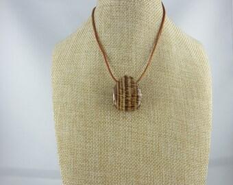 Aragonite pendant.