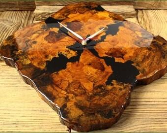 Beautiful wall clock made of wood and resin