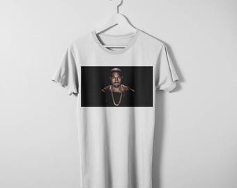 Kanye West T-shirt. Available in men's and women's sizes. Printed on a comfy Bella Canvas cotton tee.