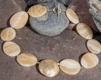 Precious stone necklace made of golden marbled calcite with gold-plated 925 silver