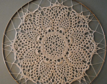 Hand crocheted doily hanging