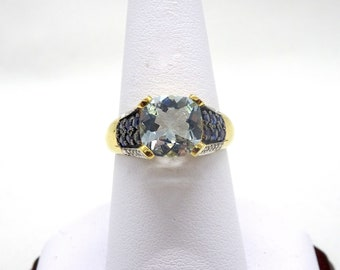 One 14kt Yellow Gold Topaz,Sapphire and Diamond Ring