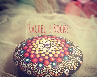 Hand painted mandala stone. Approx  3 inches by 3 inches.
