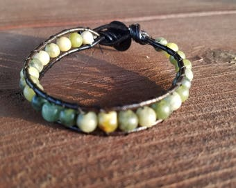 Wrap bracelet on black leather cord with jade green beads