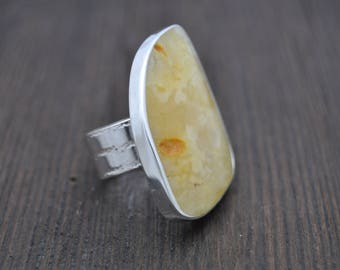 Silver ring with yellow Baltic Amber adjustable Handicraft.