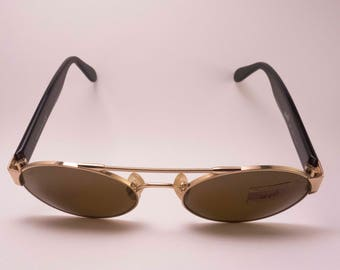 Vintage sunglasses. Manufactured by Luxottica with the Web brand