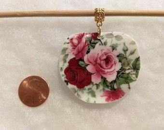 Beautiful roses on large pendant.