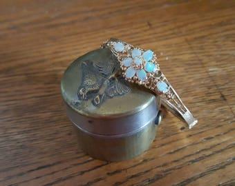 Gold and opal oval bangle bracelet