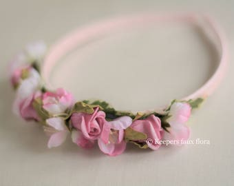 Child's pink headband with faux apple blossom and rosebuds