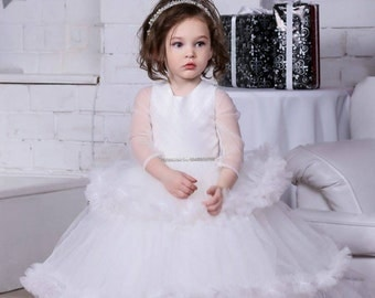 Flower girl puffy dress with long sleeve. Ruffles.