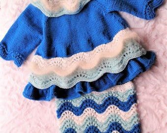 Dress and nappy cover .Robe et cache couche