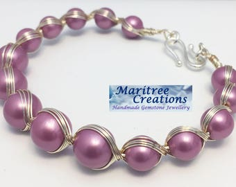 Egyption style wirework bracelet with shell pearls.