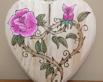Wood burned, plaque, flowers