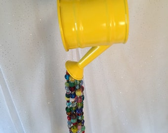 Small hanging watering can with beaded waterfall
