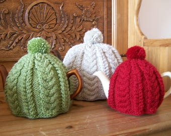 A large Cable Tea Cosy