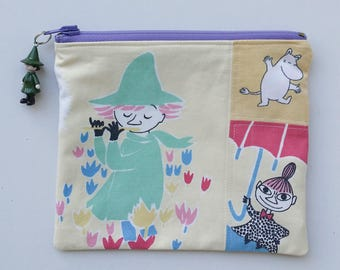 Pretty yellow blue zippered pouch and a charm with Moomins Snufkin Little My