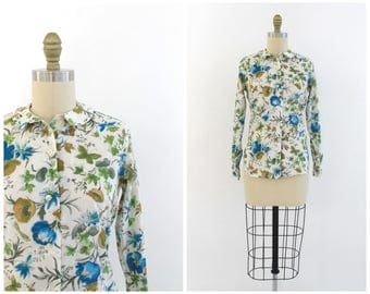 vintage 1960s white cotton blouse with blue floral print | 60s long sleeve button up blouse | vtg flower print top | x-small