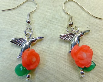 Pewter Hummingbird Charms Below Hand Carved Coral Pink Roses and Green Glass Leaves Dangle Earrings
