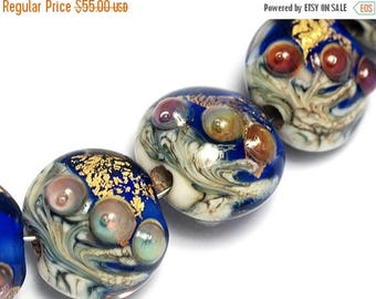 ON SALE 30% off Seven Cobalt Treasure Lentil Beads -10410002-Handmade Lampwork Glass