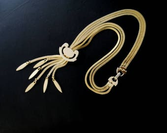 Mod vintage 60s, gold tone metal, multistrand  necklace -tie with a a geometric design slider pendant. Made by Monet.